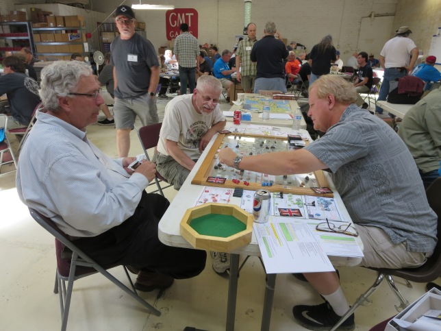 7YW Frederick's Gamble: Dave and Eric being shown the game by the designer Greg Ticer