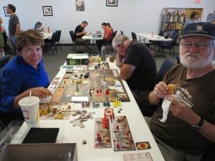 Maura, Larry, And David play Scythe