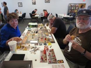 Maura, Larry, And David play Scythe